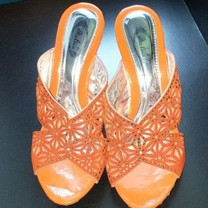 Orange rhinestone heels